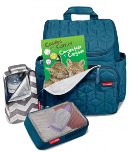 Small stroller-bag book pokes out of a blue diaper bag, all ready to go.